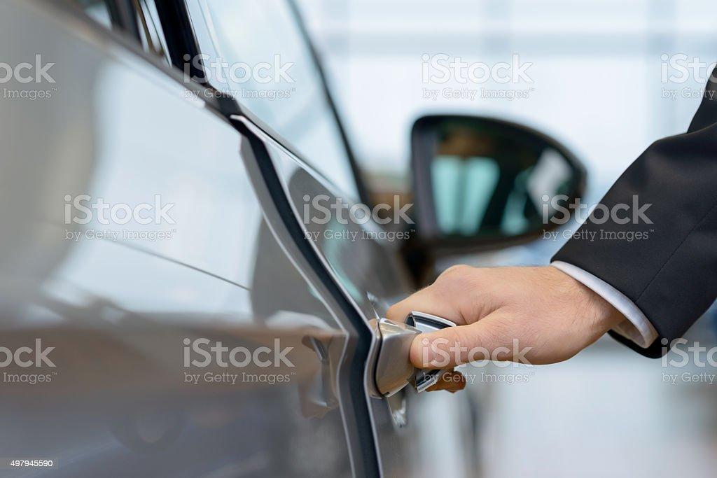 Car door is about to be opened stock photo
