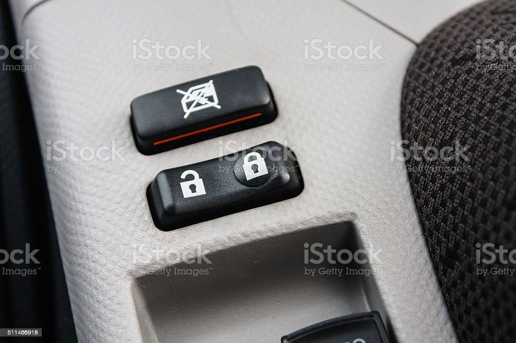 Car Door Lock Button Closeup stock photo
