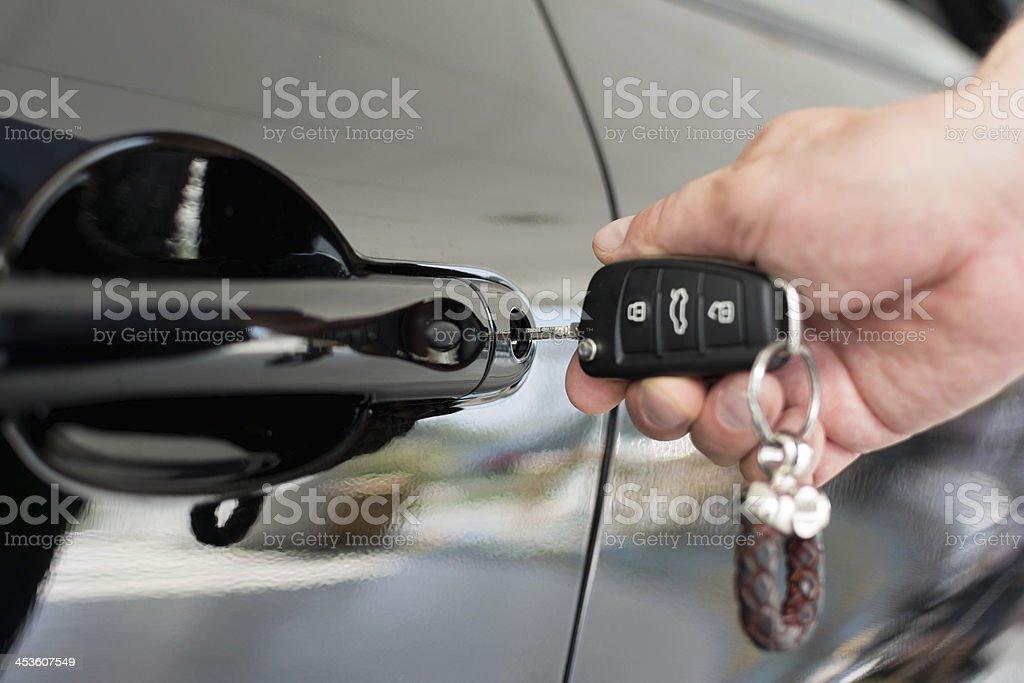Car door unlock by key royalty-free stock photo