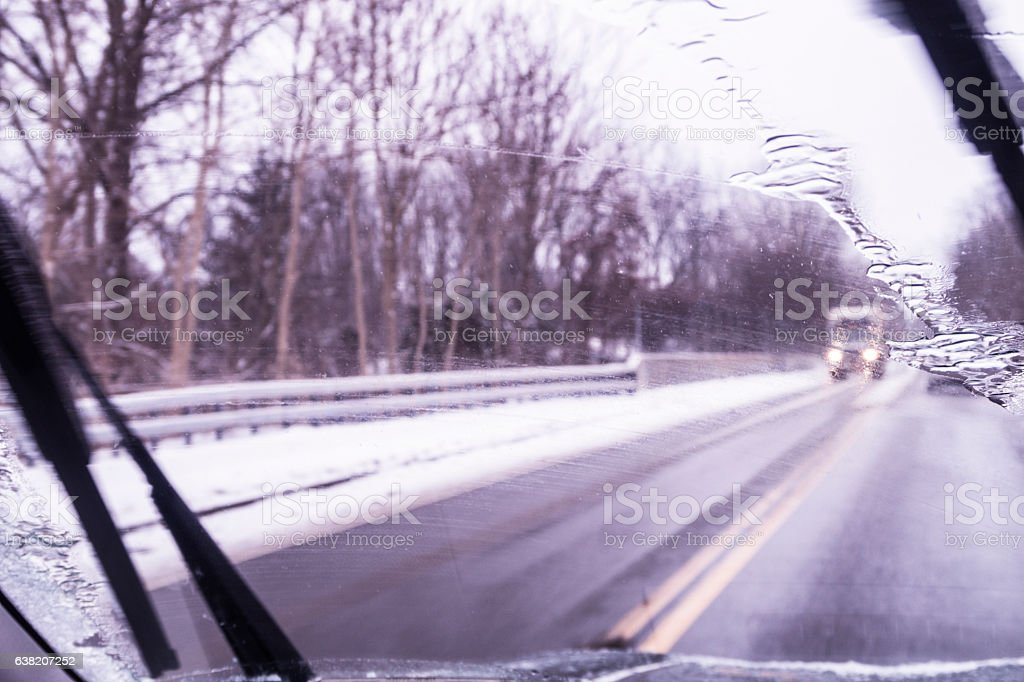 Car Driver Abstract POV Through Freezing Rain Winter Weather Windshield stock photo