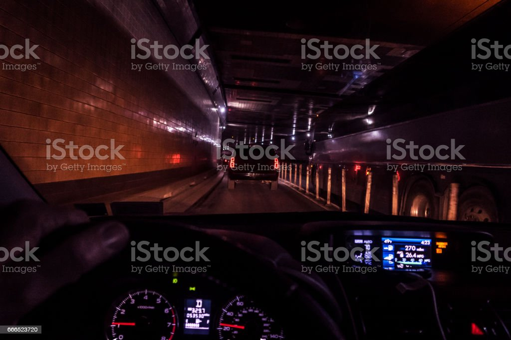Car Driver POV Driving Through Claustrophobic Lincoln Tunnel stock photo