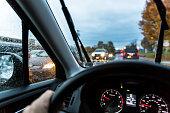Car Driver POV Perspective - Approaching Traffic Through Rainy Windows