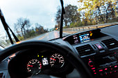 Car Driver POV Perspective Over Steering Wheel and Digital Dashboard
