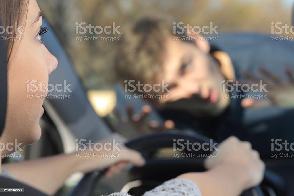 Car driver running over a pedestrian stock photo