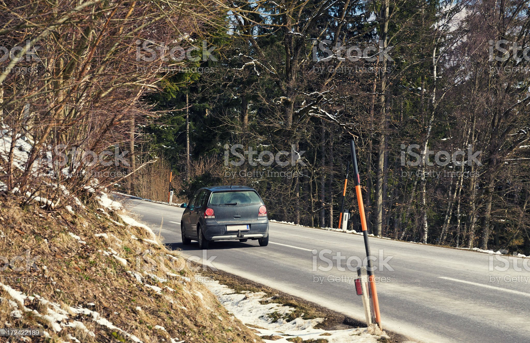 Car driving along a mountain pass royalty-free stock photo