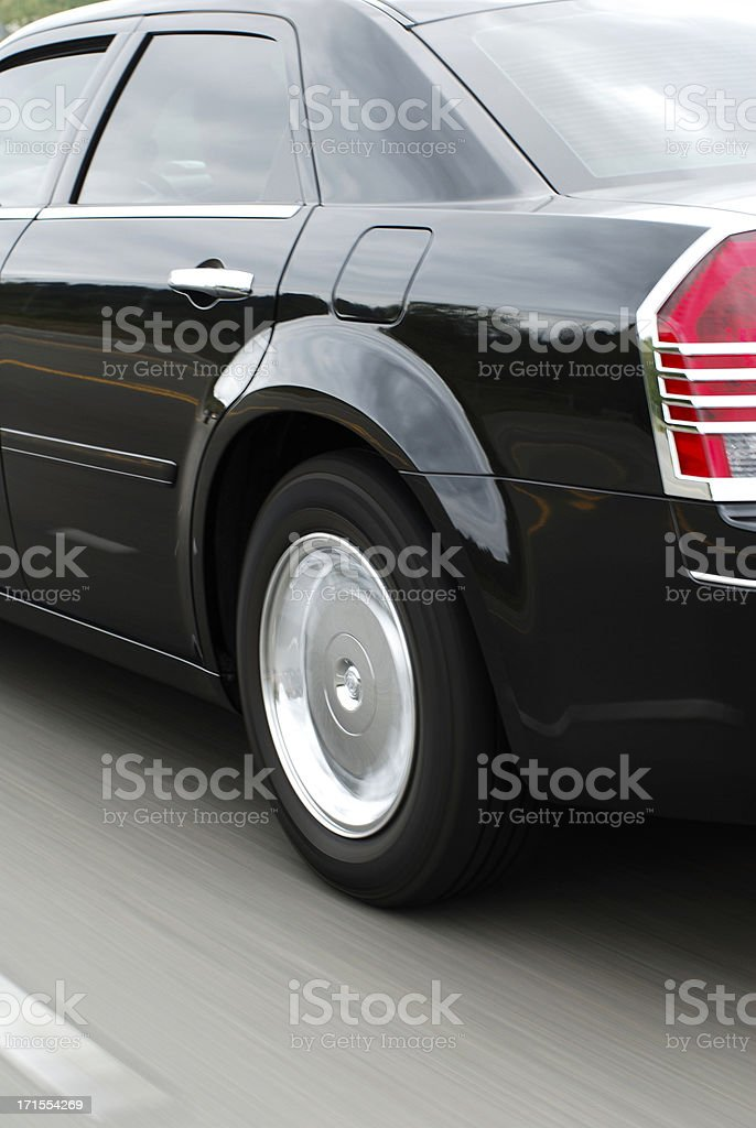 car driving down the road high speed stock photo