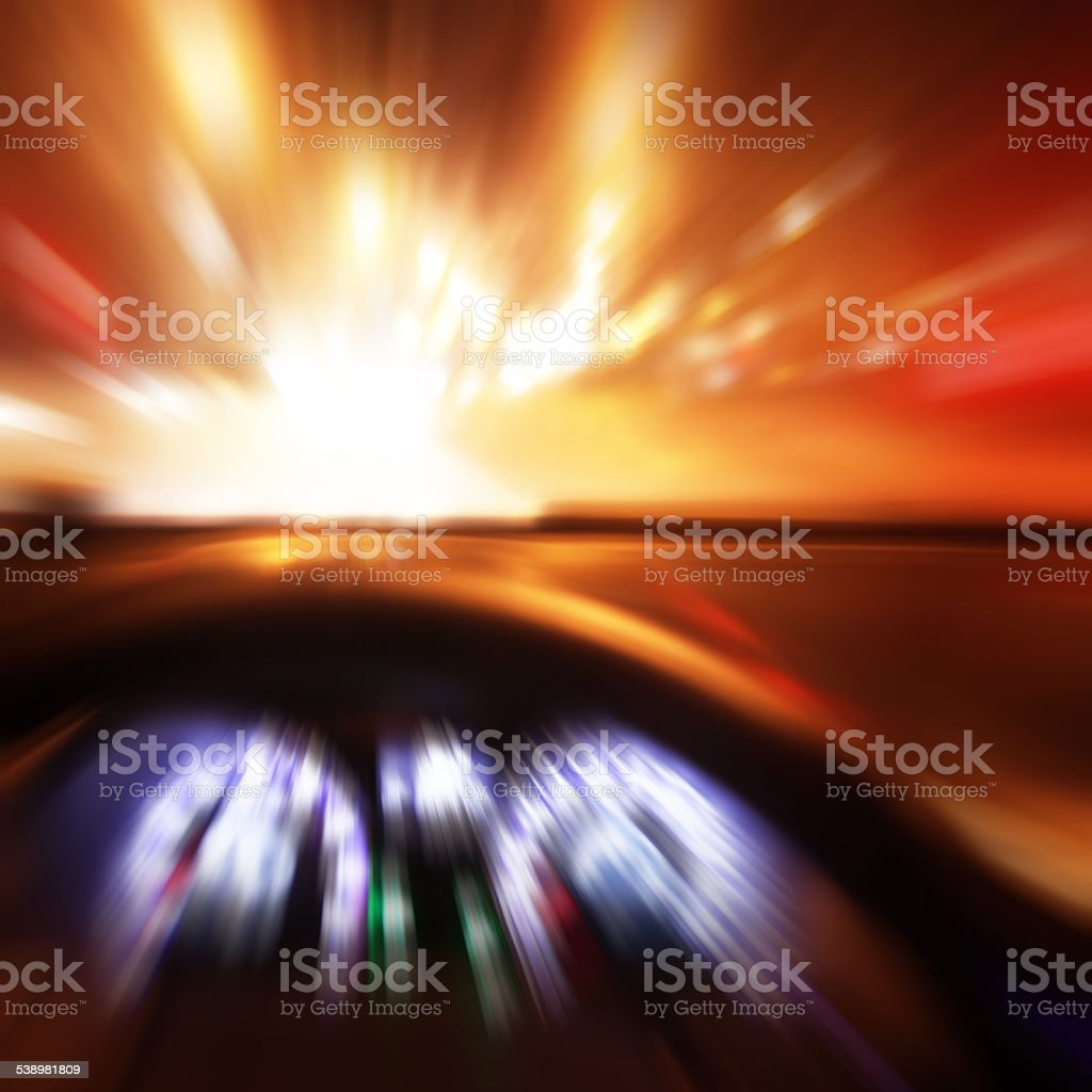 Car driving fast at sunset. Motion blur. stock photo