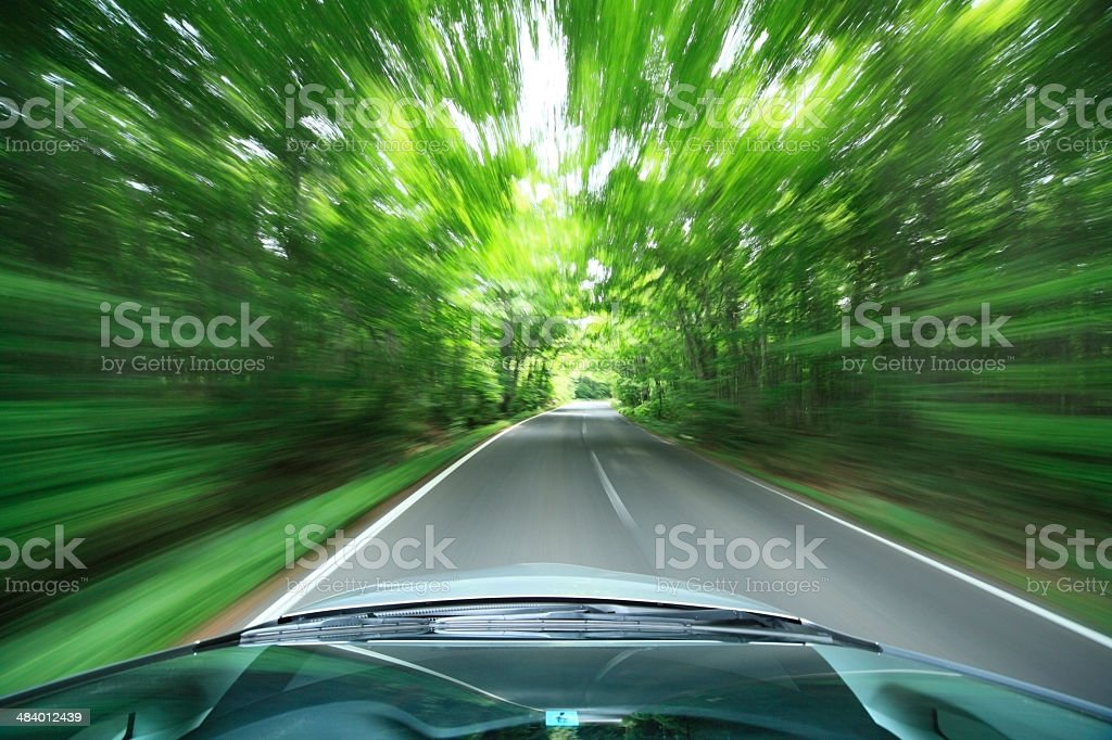 car driving fast into forest royalty-free stock photo
