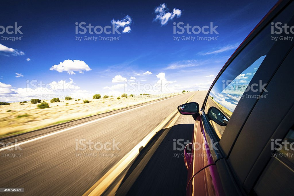 Car Driving Fast on Highway stock photo