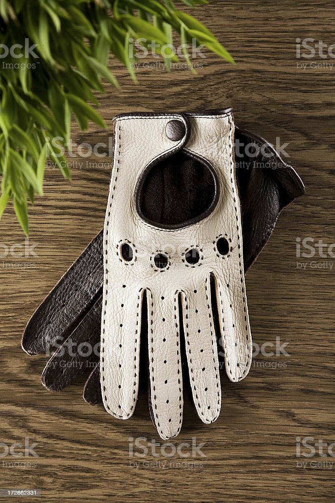 Car Driving Gloves On Wooden Table stock photo