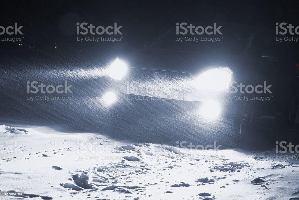 Car driving in a Snowstorm royalty-free stock photo