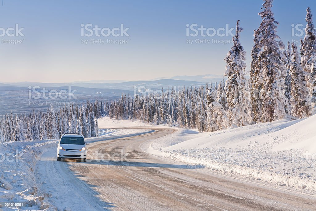Car Driving in the Remote Winter Highway stock photo