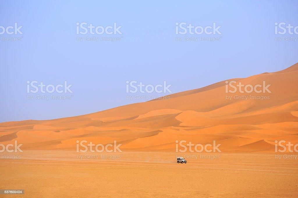 car driving in the Sahara Desert stock photo