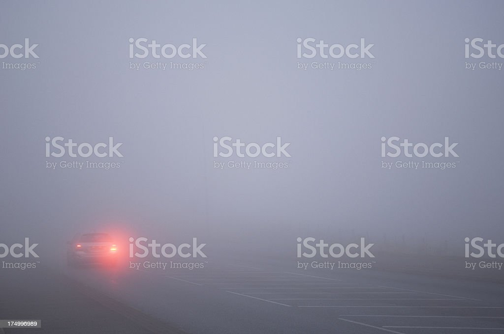 Car driving in thick fog royalty-free stock photo