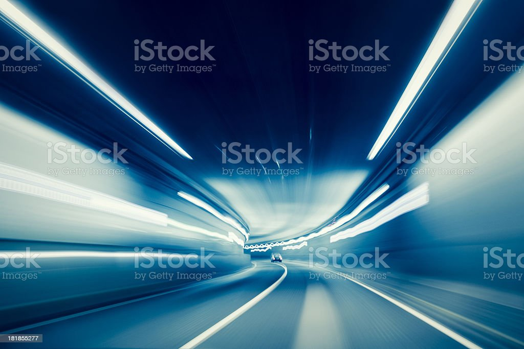 Car driving in tunnel with long exposure light streaks stock photo