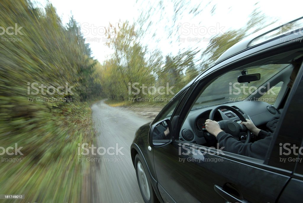 Car driving on country road stock photo
