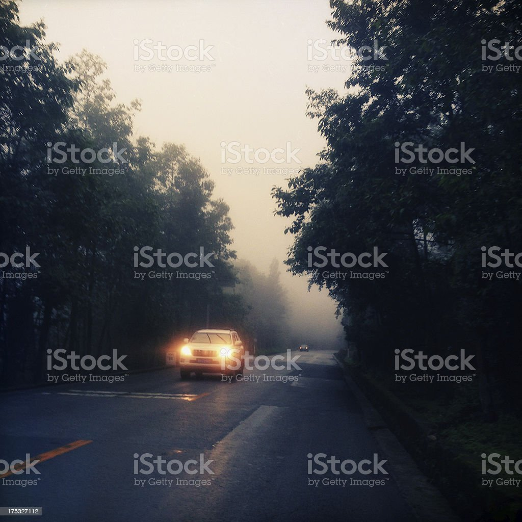 Car driving on mountain road royalty-free stock photo
