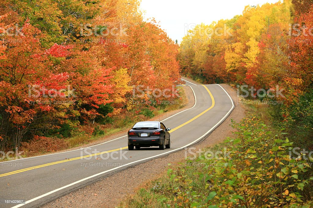 Car Driving on Remote Appalachian Highway in Fall stock photo