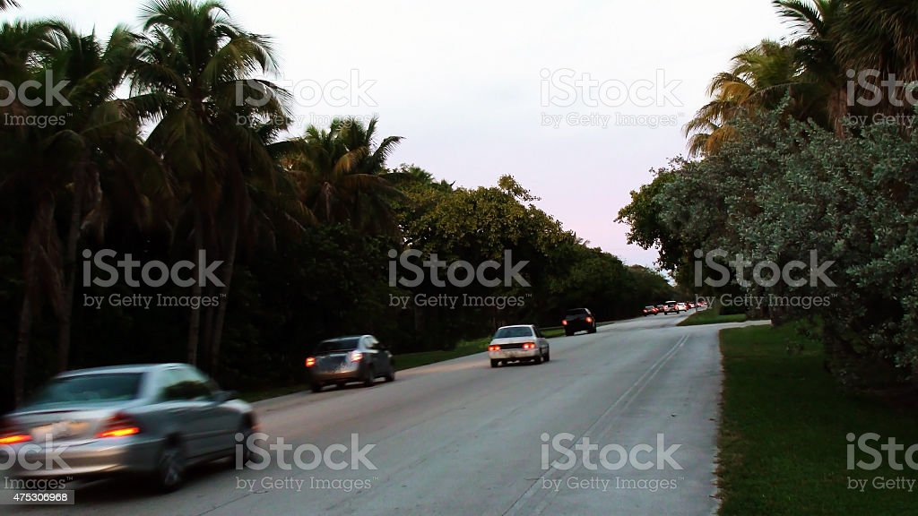 Car Driving on Remote Miami Highway in Summer. Florida USA stock photo