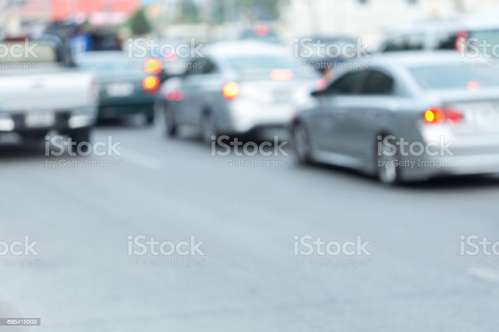 car driving on road with traffic jam in the city, abstract blurred background stock photo