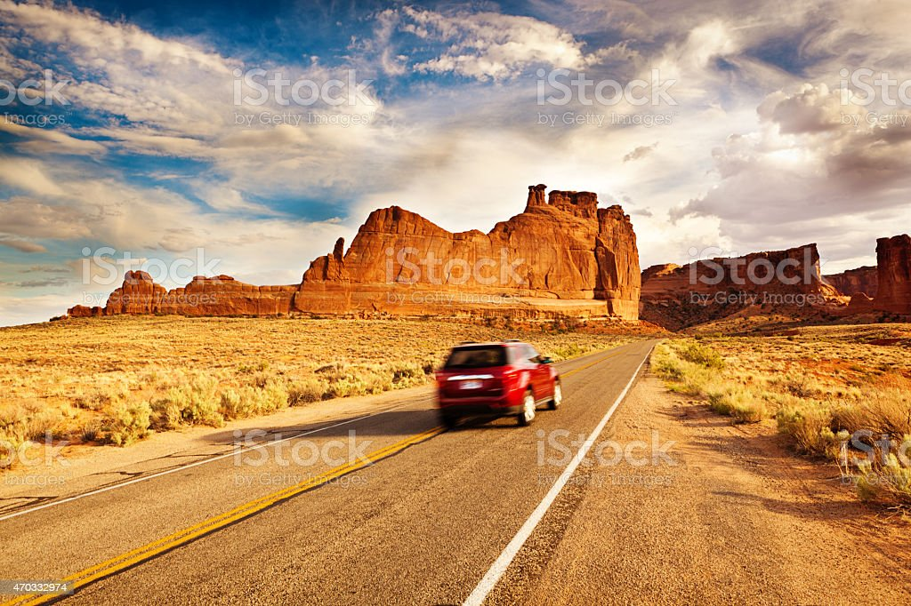 Car Driving Road Trip Touring at Arches National Park Utah stock photo