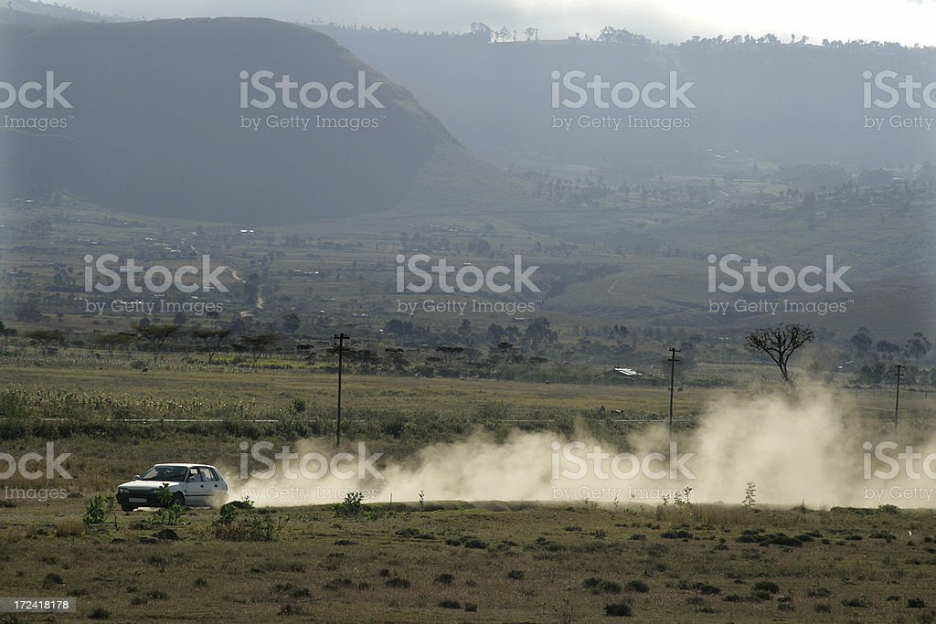 Car driving through an African Landscape royalty-free stock photo