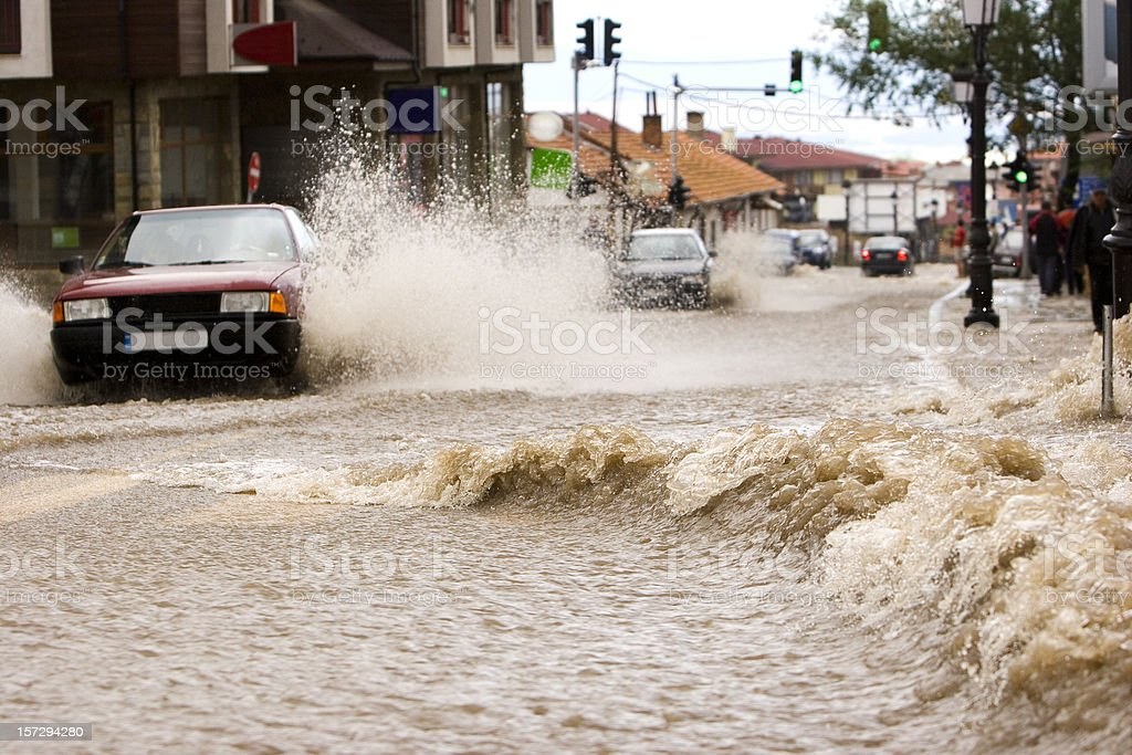 Car driving through flood water on a road in Bulgaria royalty-free stock photo