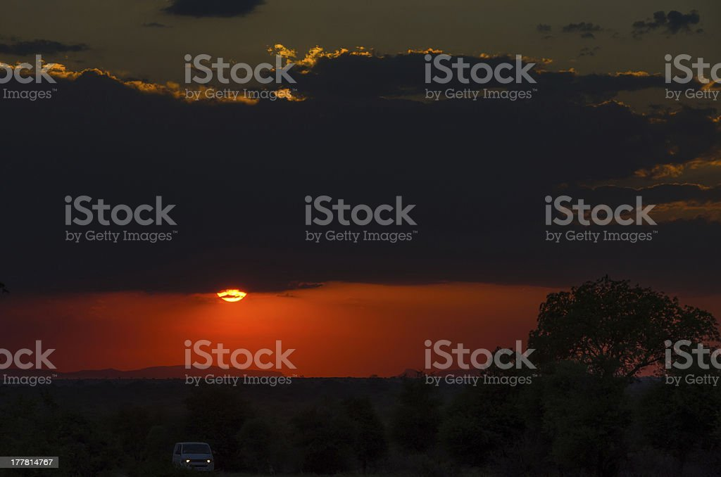 Car driving through Kruger National Park at Sunset royalty-free stock photo