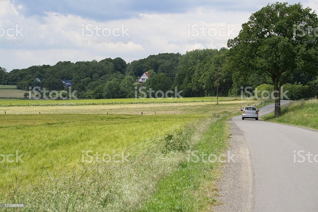 car driving through nice landscape royalty-free stock photo