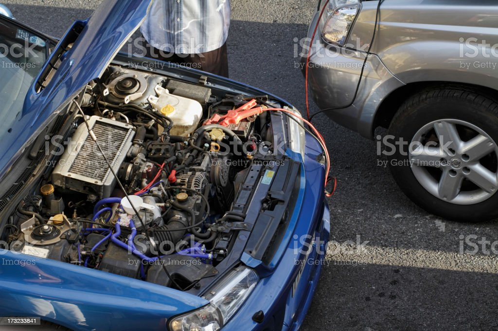 Car engine jump start between two vehicles stock photo
