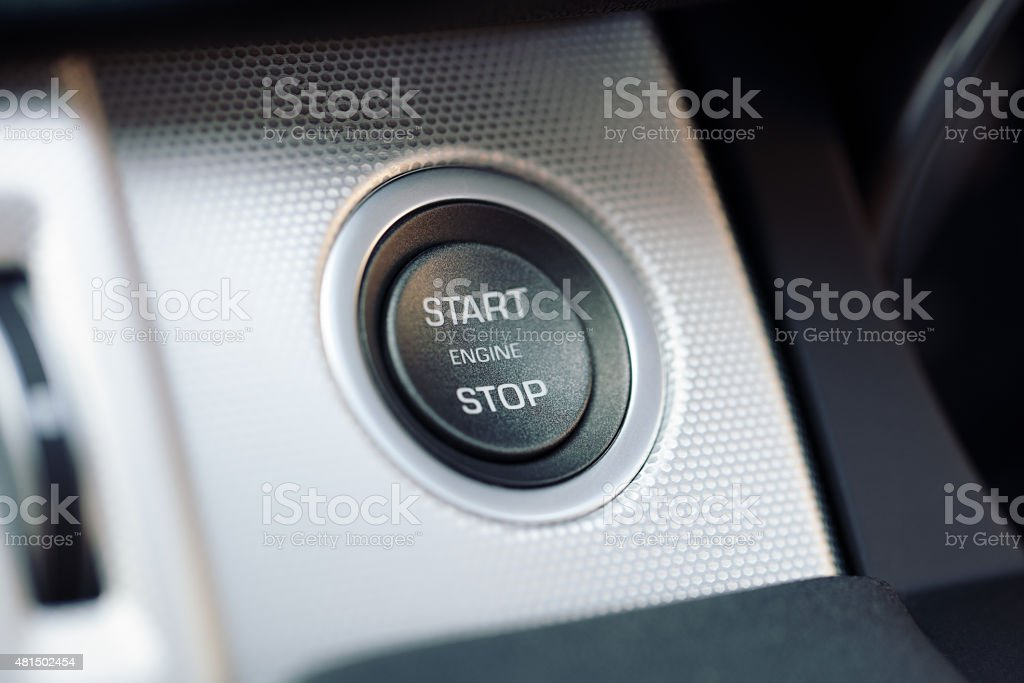Car engine start and stop button on a hybrid car stock photo