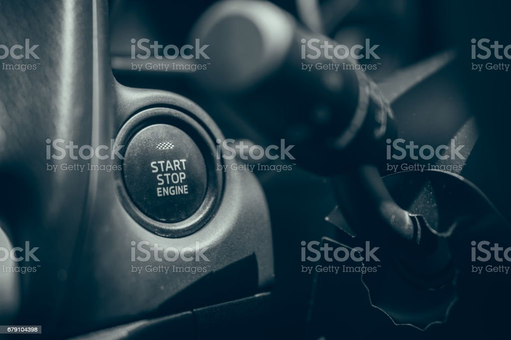 Car engine start and stop button stock photo