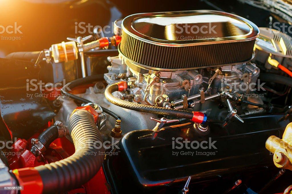 Car engine under hood at sunset stock photo