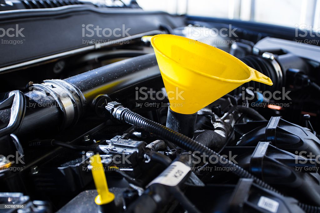 Car engine with oil funnel stock photo