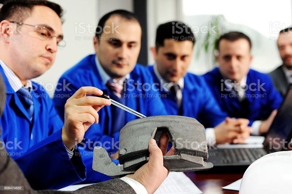 Car engineers meeting stock photo