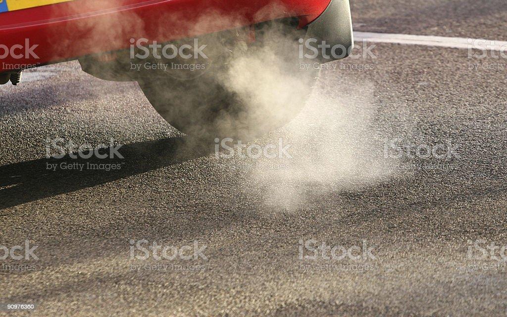 Car exhaust fumes polluting the air in an urban environment stock photo