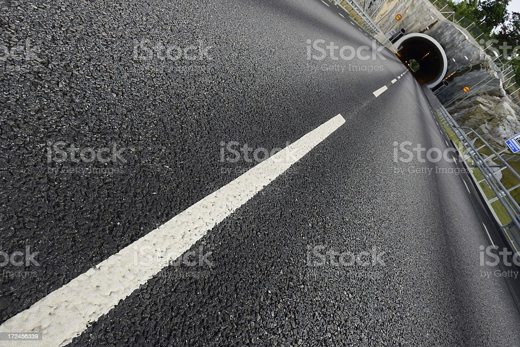 Car exiting tunnel, diminishing perspective royalty-free stock photo