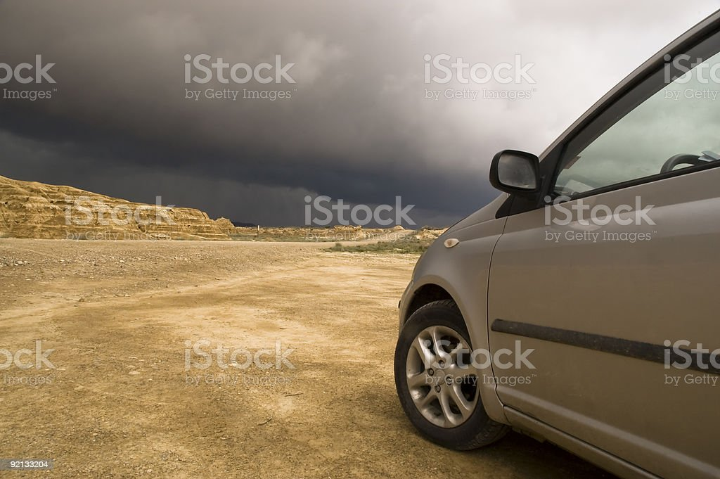 car facing a storm stock photo