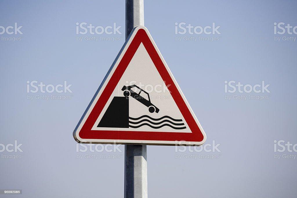 Car falling off pier hazard sign royalty-free stock photo