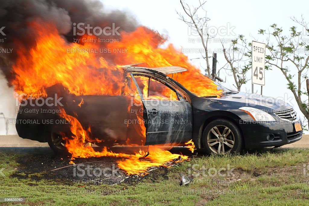 Car fire, burning profusely on New Jersey highway stock photo