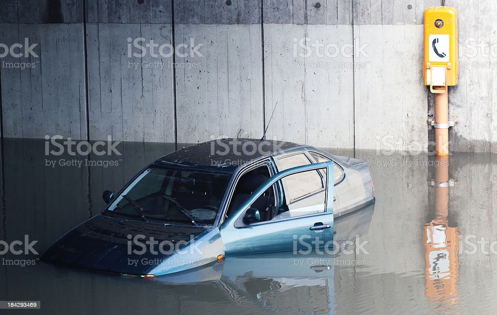 Car flooded right next to emergency phone stock photo