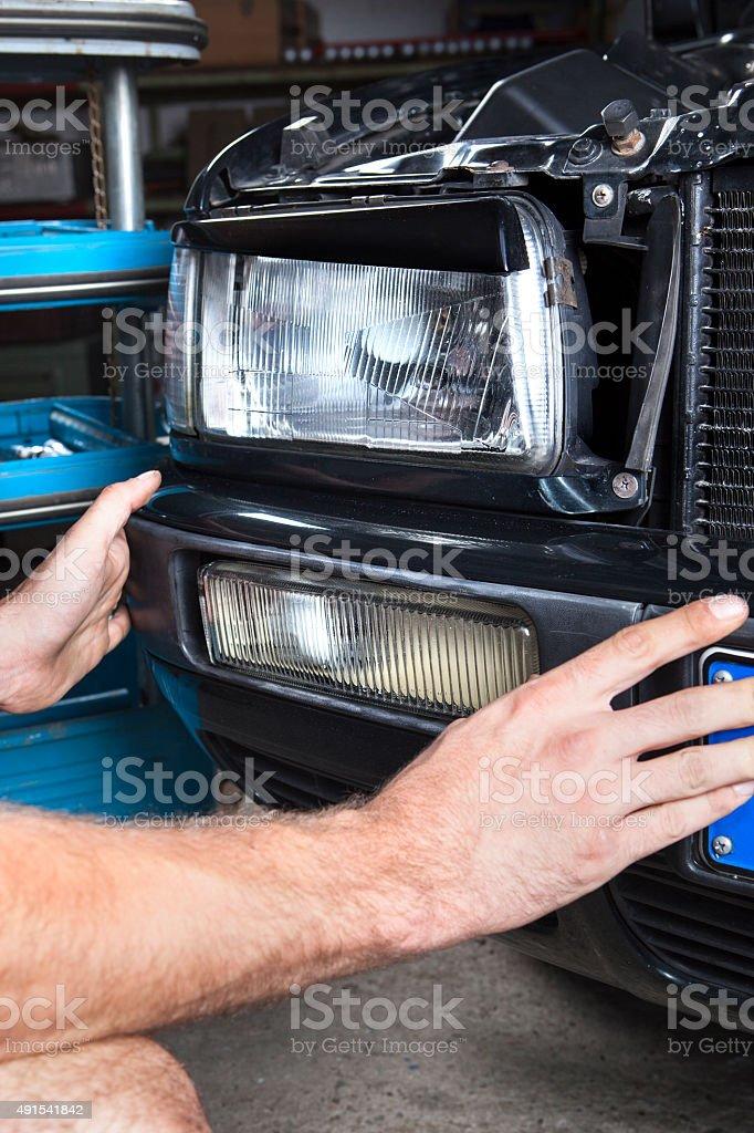 Car fog headlight mechanic repair stock photo