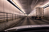 Car Following Trailer Truck Inside Pennsylvania Turnpike Lehigh Road Tunnel