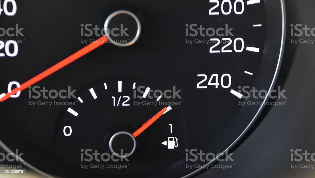 car fuel gauge indicating full stock photo
