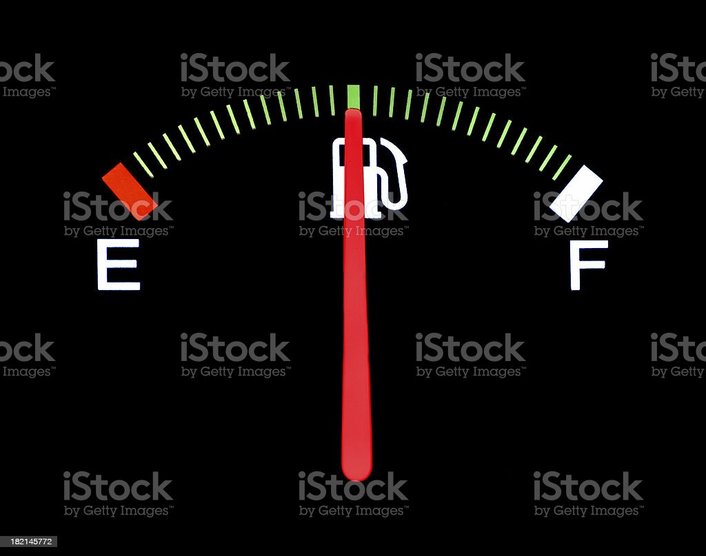 Car fuel gauge shows half full on black background royalty-free stock photo