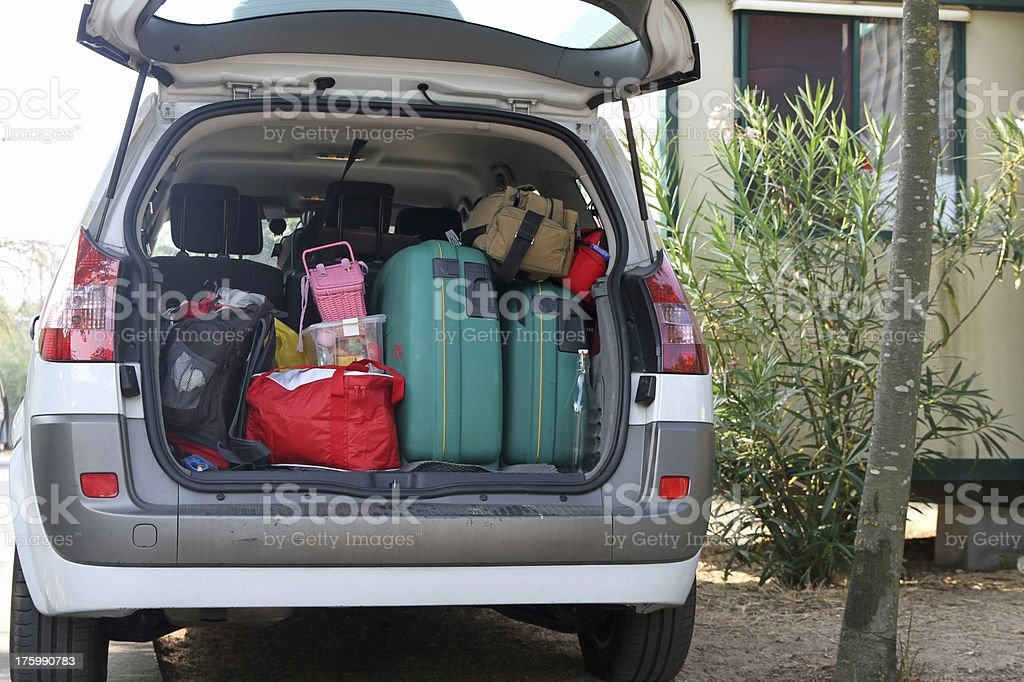 Car full of suitcases and bags stock photo