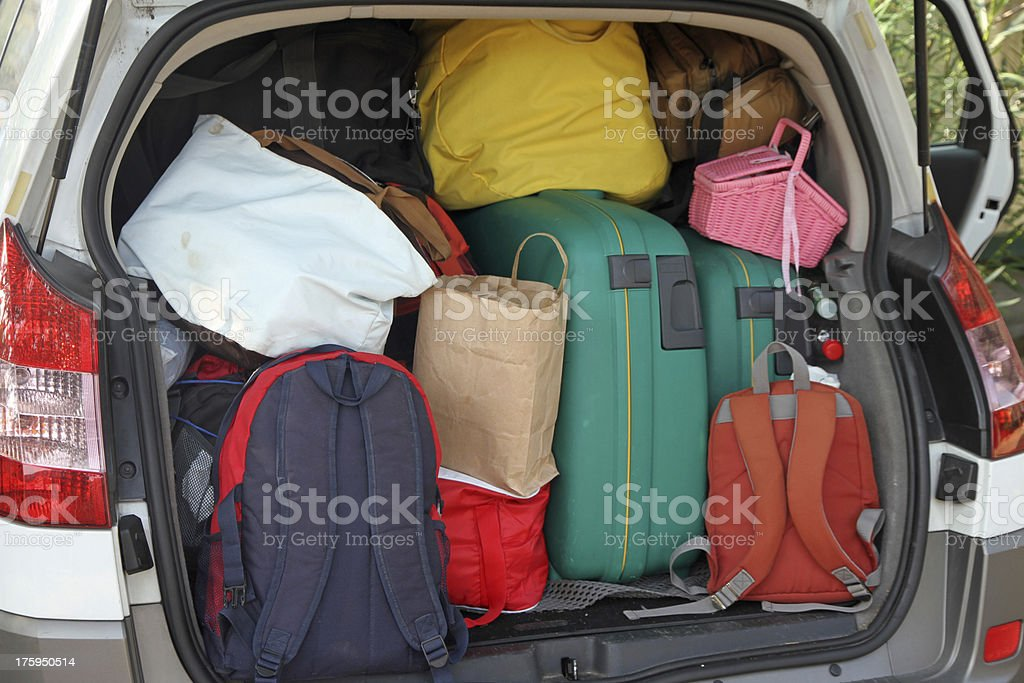 Car full of suitcases and bags to return from holidays stock photo