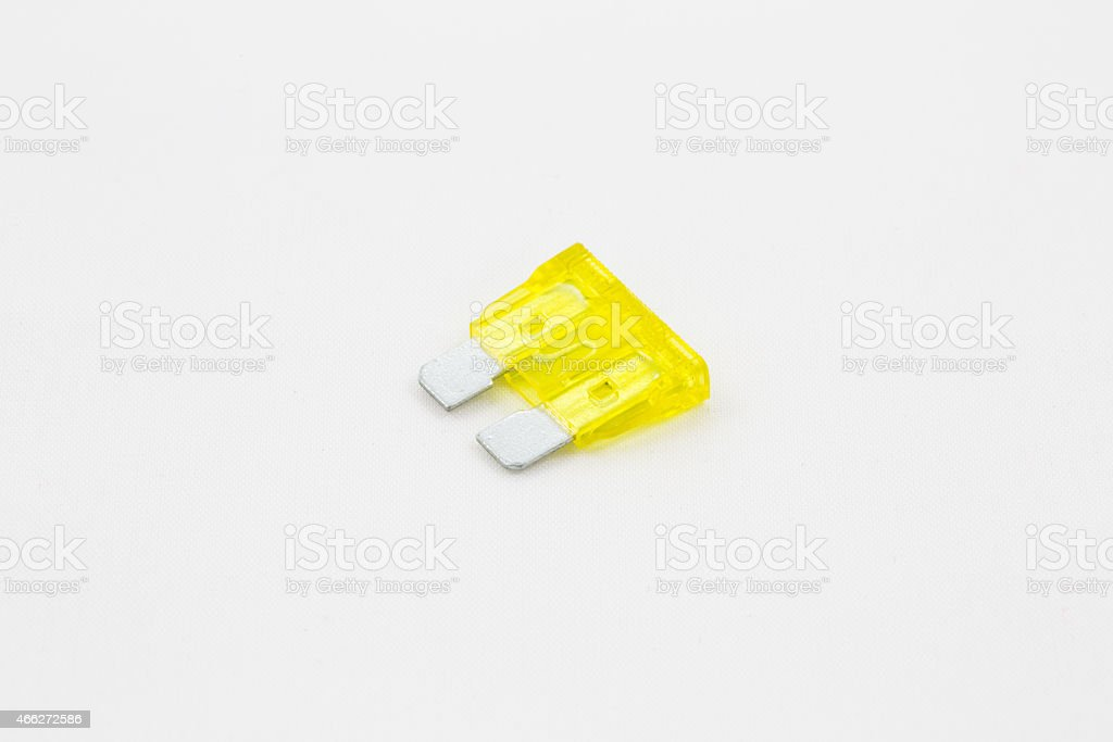 Car fuse, shown in close up isolated on white background royalty-free stock photo