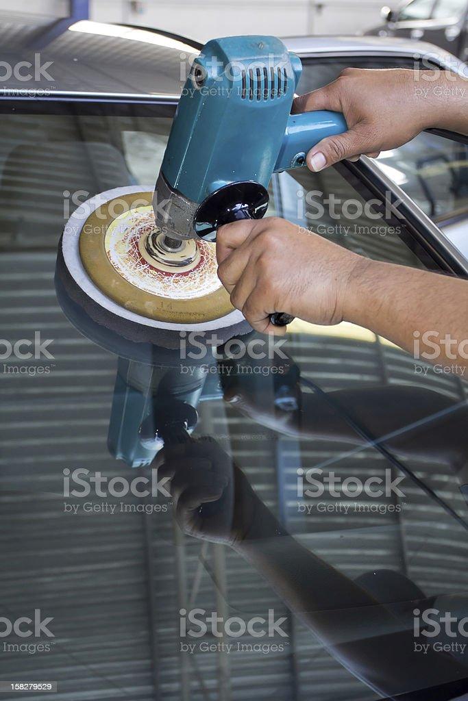 Car Glass polishing with power buffer machine royalty-free stock photo