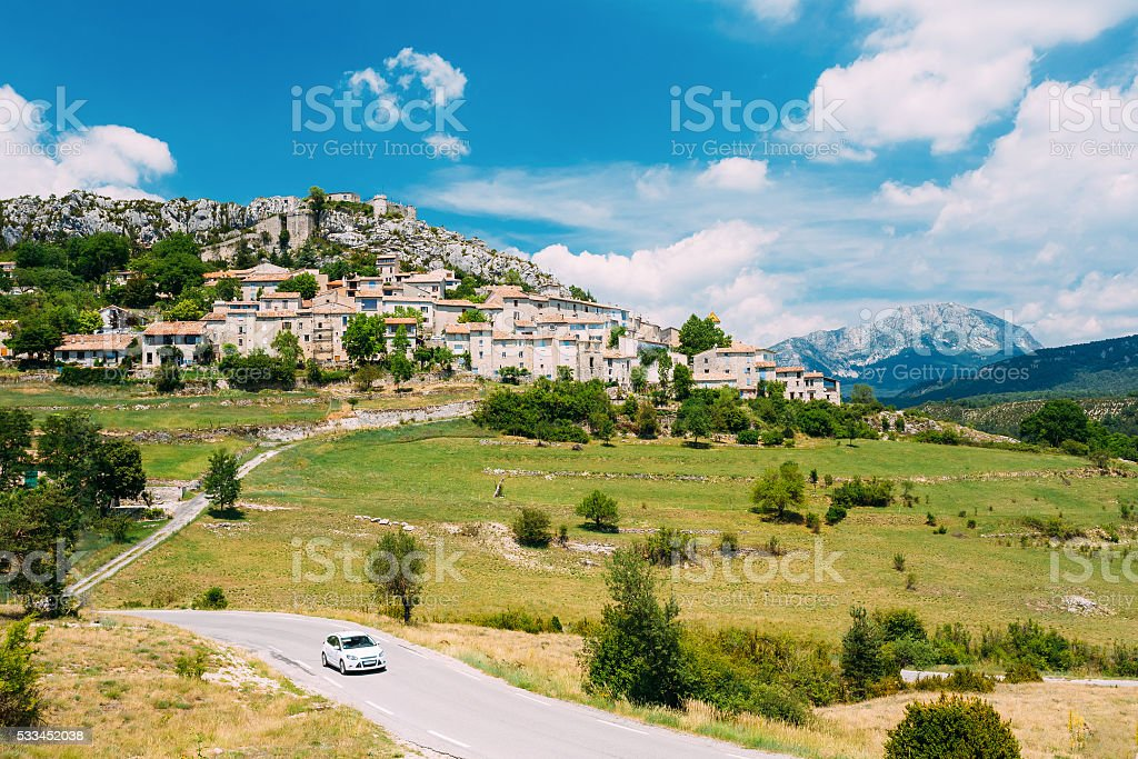 Car Goes On Road Near Medieval Hilltop Village , Trigance,  France stock photo